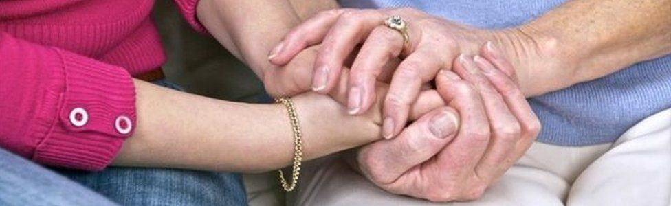 Holding hands with OAP