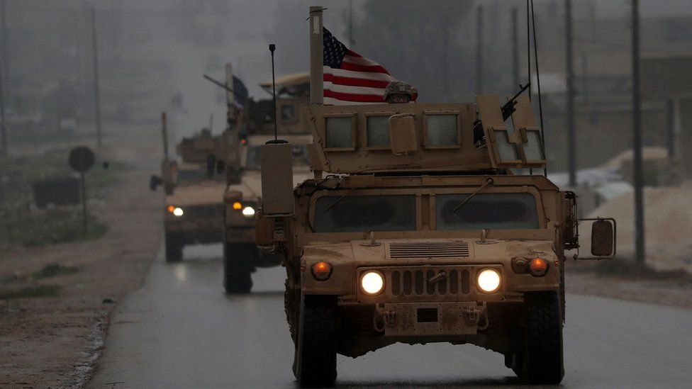 US military vehicles in Syrian town of Manbij on 30 December 2018