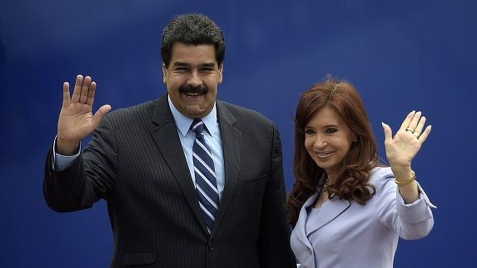 Argentina's President Cristina Fernandez (right) and Venezuela's Nicolas Maduro wave during the 47th Mercosur Summit family photo, in Parana, Entre Rios, Argentina on 17 December, 2014.