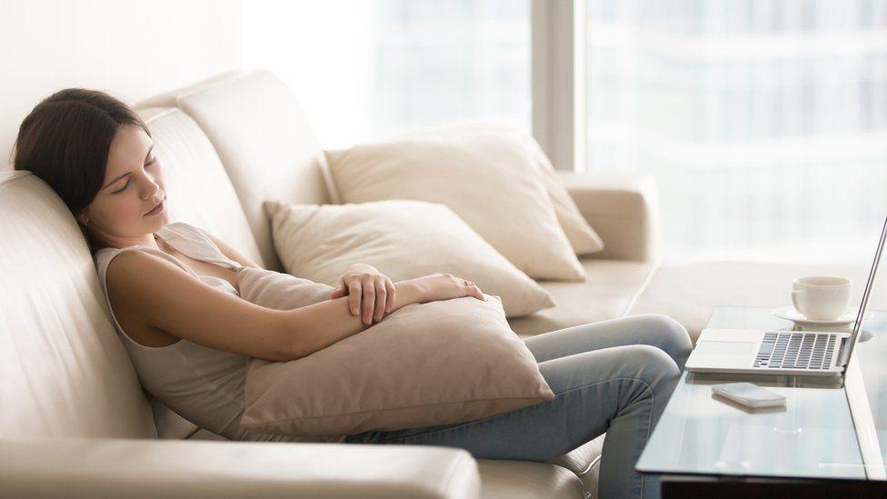 Young girl sleeping on the sofa