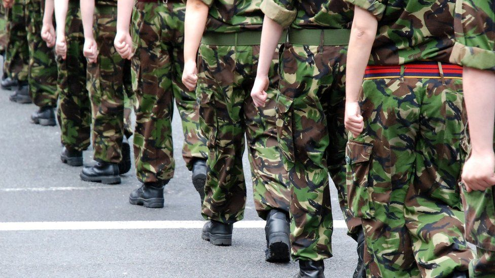 Soldiers marching - stock photo