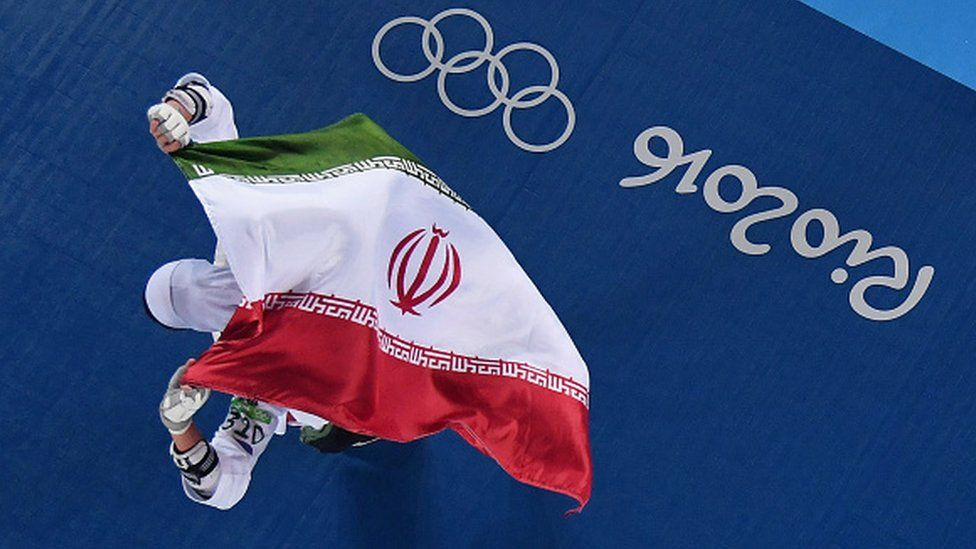 Kimia Alizadeh Zenoorin of the Islamic Republic of Iran celebrates after defeating Nikita Glasnovic of Sweden at the 2016 Olympic Games