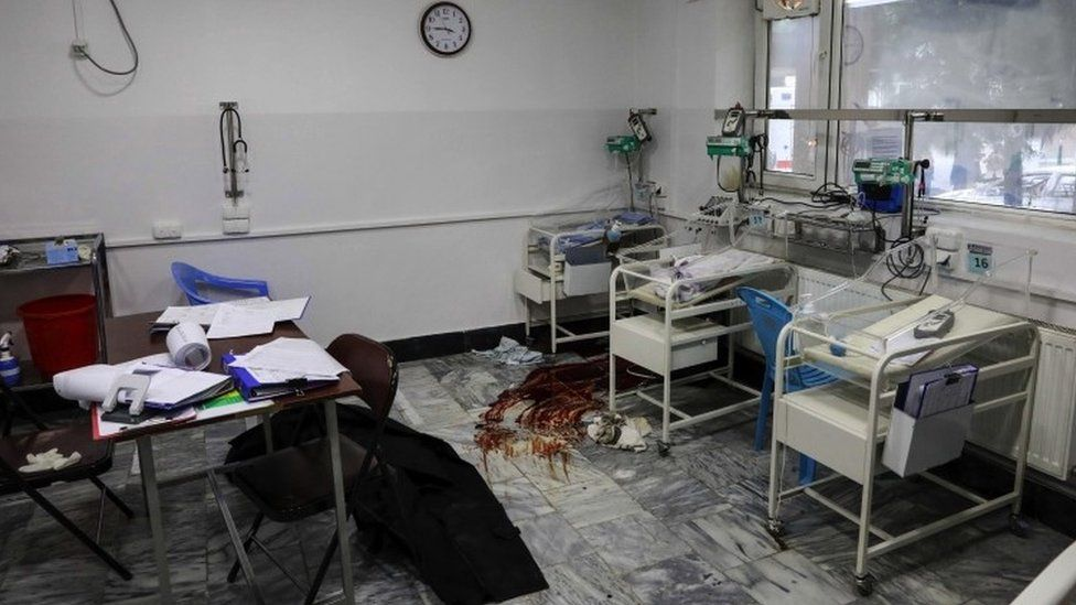 Blood smeared on the floor of the hospital near some cribs