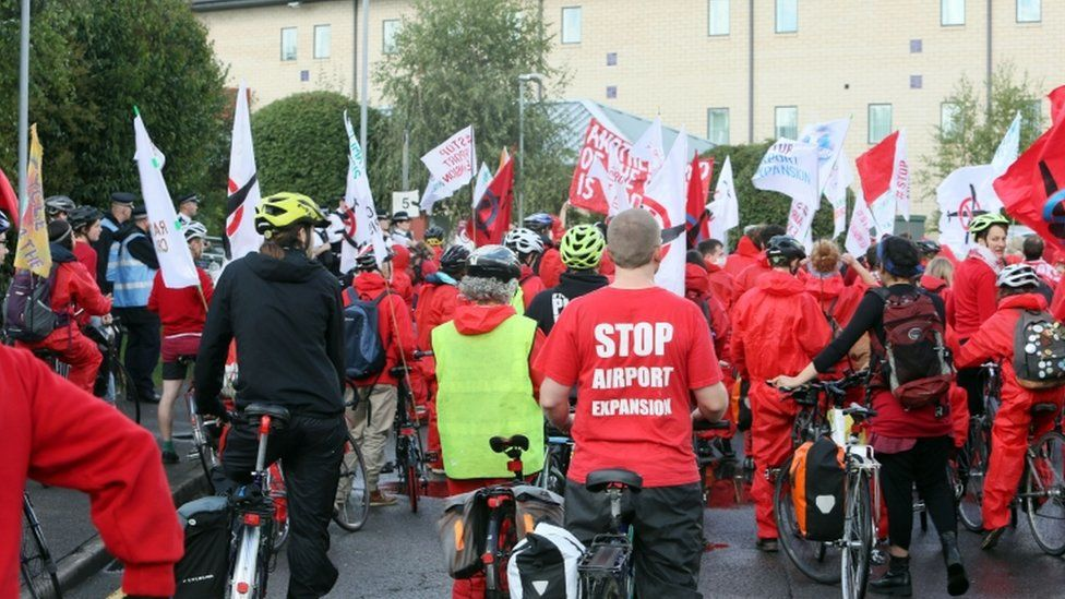 Climate change protesters hold a cycle rally near Heathrow
