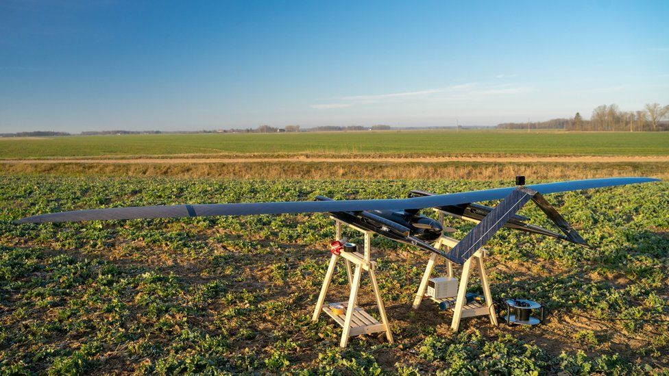 The UAV is seen on a stand in a farmer's field in this photo