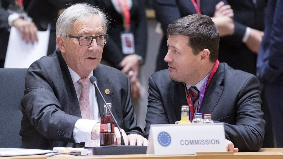 Jean-Claude Juncker (L) is talking with his cabinet chief Martin Selmayr (R) in December 2017