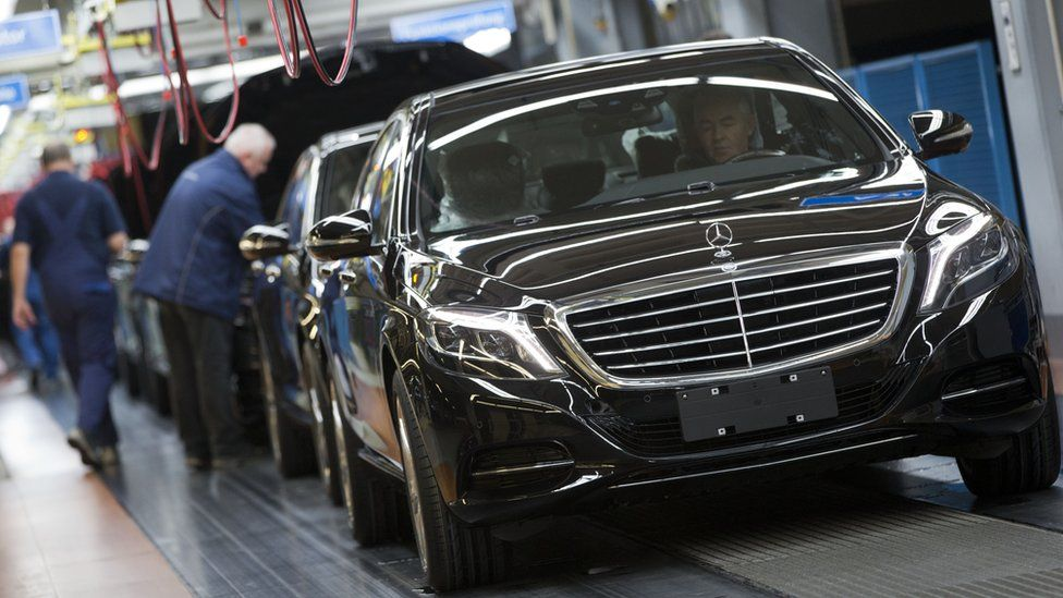 An employee of the Mercedes-Benz AG checks a S-Class model at the plant in Sindelfingen, Germany.