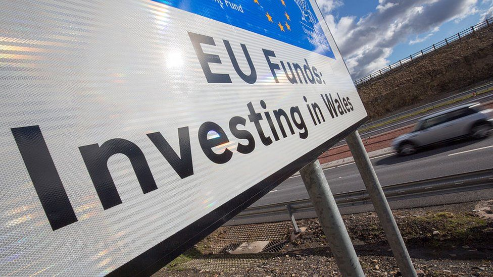 A car passes a European Union funding sign on the newly opened A465 near Ebbw Vale