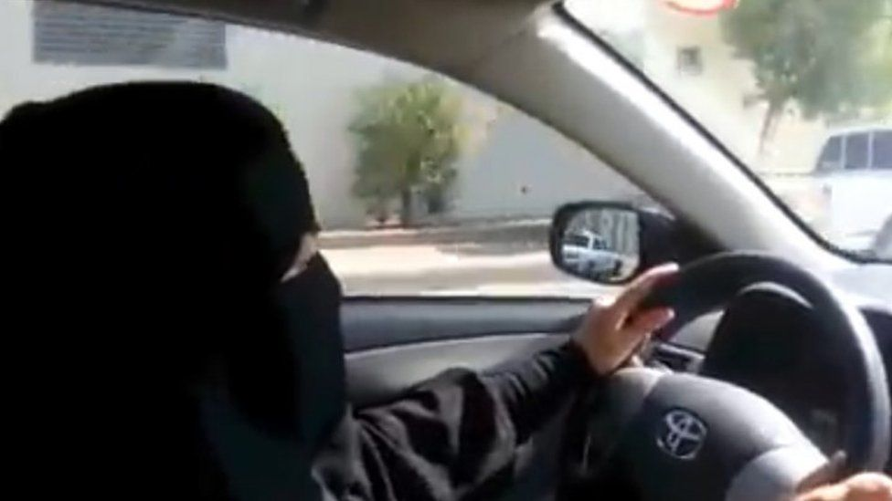 A fully veiled woman driving in Riyadh ahead of a nationwide day of defiance of the female driving ban (17 October 2013)