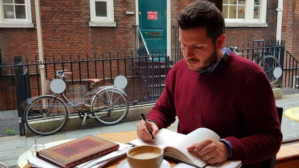 Thomas Leeds writing his adventure story