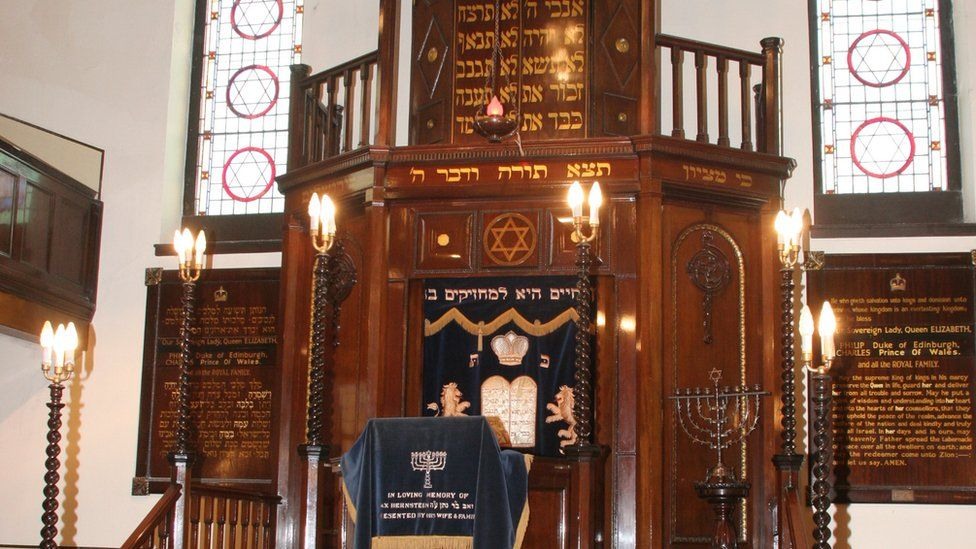 The interior wooden altar with Jewish signs and decorations