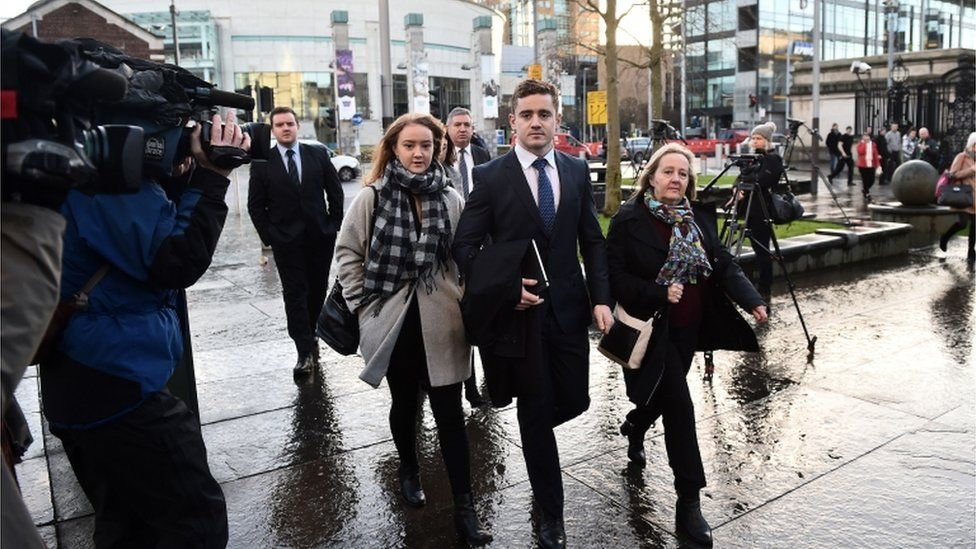 The case involving Paddy Jackson, centre, attracted huge media attention over nine weeks