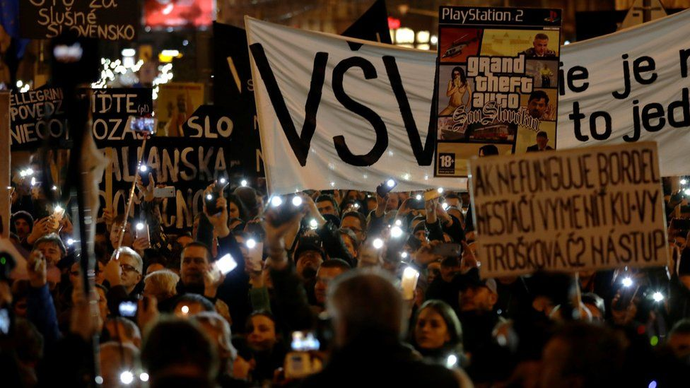 """People take part in a rally near the Slovak National Uprising square against corruption and to pay tribute to murdered Slovak journalist Jan Kuciak under the slogan """"For a Decent Slovakia"""", on March 16, 2018 in Bratislava, Slovakia"""