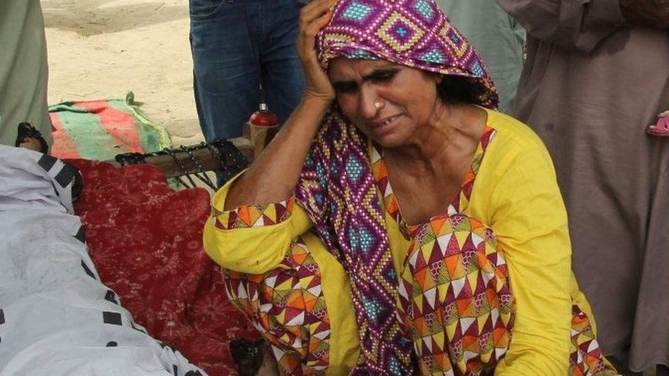 Mother of social media celebrity, Qandeel Baloch mourns alongside her body during her funeral in Shah Sadar Din village, around 130 kilometers from Multan on July 17, 2016.