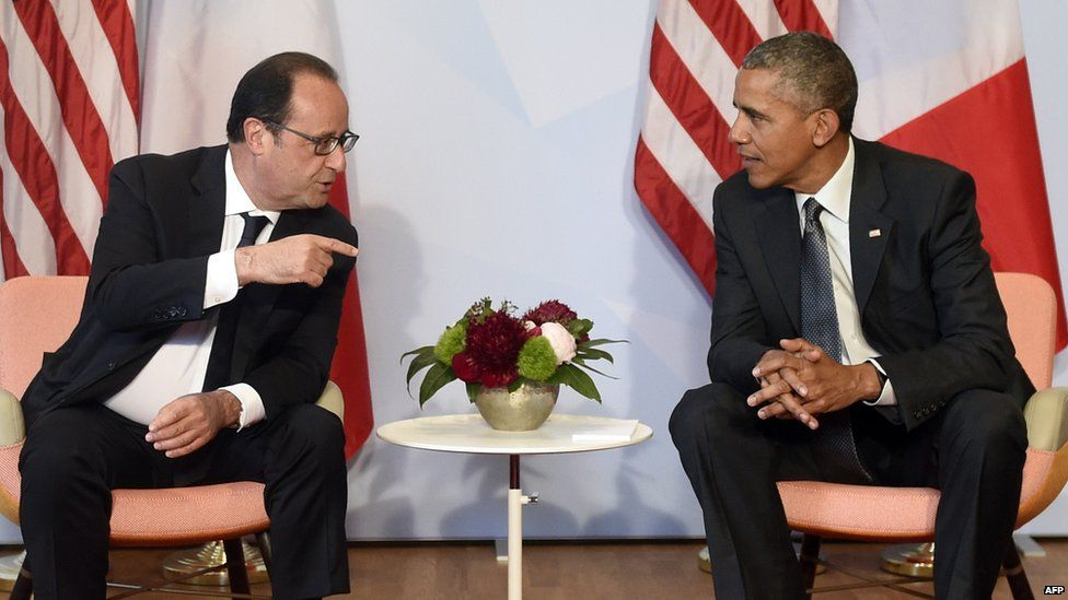 US President Barack Obama (R) and French President Francois Hollande take part in a bilateral meeting on the sidelines of the G7 Summit on 8 June