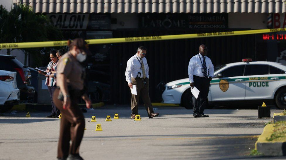 Officers examine the scene of a shooting outside a banquet hall in Hialeah, Florida
