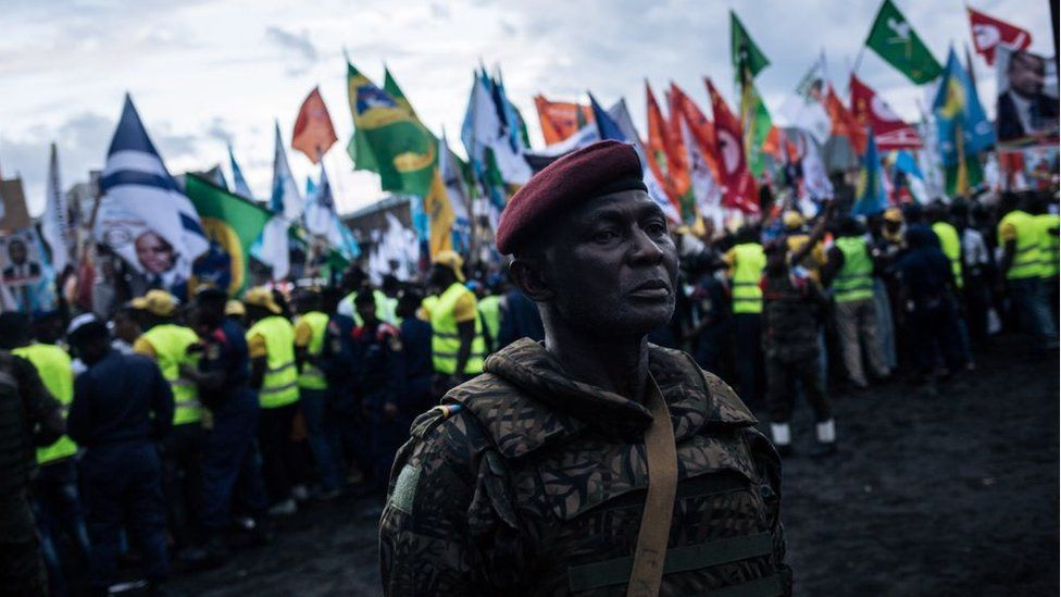 A military officer stands in front of the crowd during the election rally of the presidential candidate Emmanuel Ramazany Shadary in Goma, North-Kivu, on December 16, 2018