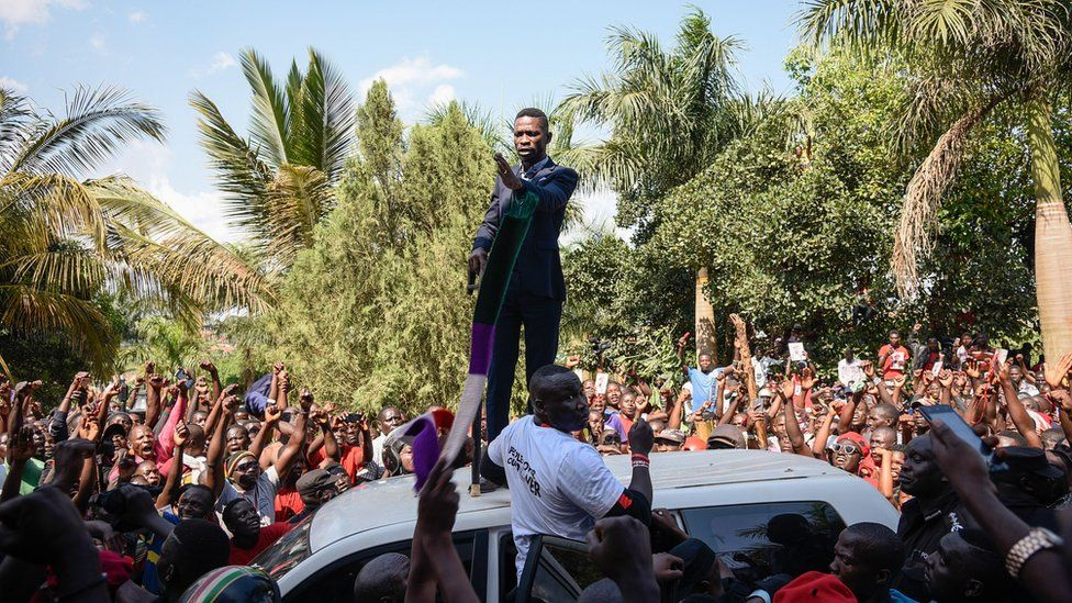 Ugandan pop star turned opposition MP, Robert Kyagulanyi, delivers a speech outside his home in Kampala, Uganda