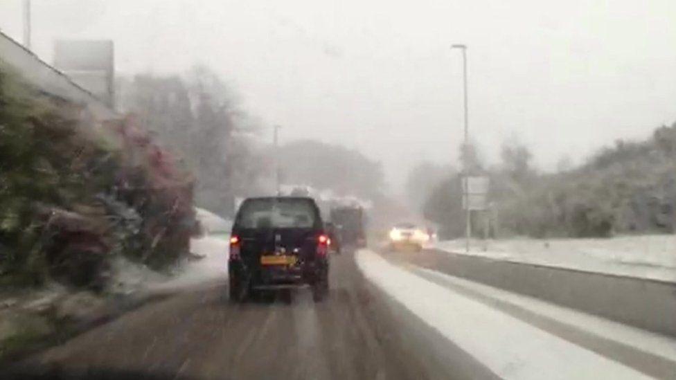 snowy road scene shot from dashboard