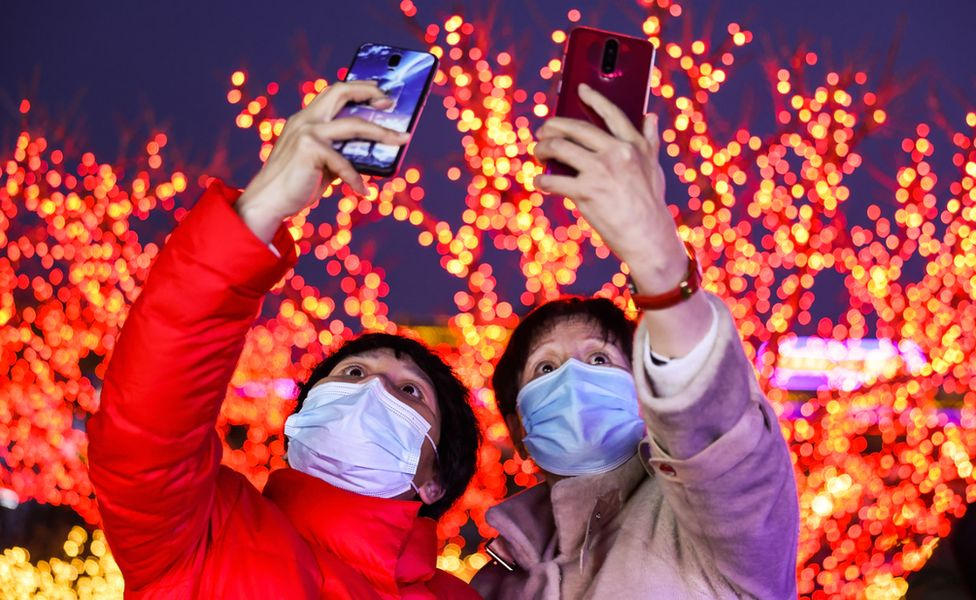 People take selfies at a lantern show in Beijing, China. Photo: 26 February 2021