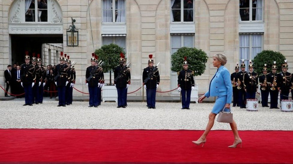Brigitte Trogneux arrives to attend the handover ceremony between her husband, French President-elect Emmanuel Macron, and outgoing President Francois Hollande at the Elysee Palace in Paris, France, 14 May 2017.