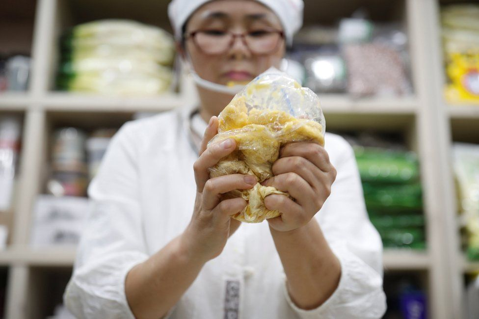 North Korean defector Hong Eun-hye demonstrates how North Korean people make rice cakes with corn powder at her North Korean food store in Seoul, South Korea, 28 September 2017.