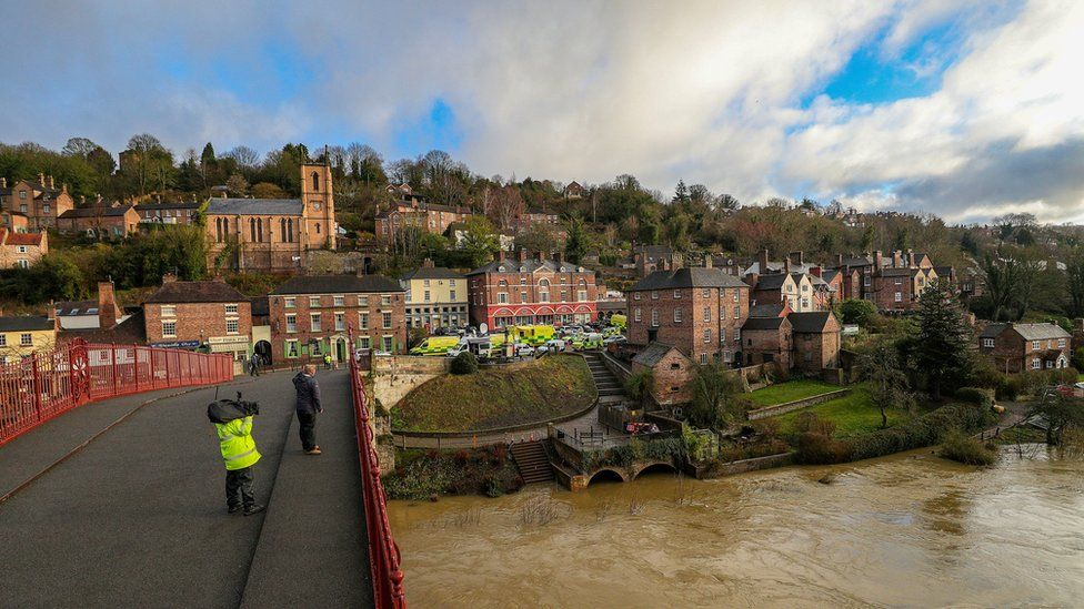 Flooding in Ironbridge, Shropshire, on 27 February, as residents in riverside properties in the area have been told to leave their homes and businesses immediately after temporary flood barriers were overwhelmed by water