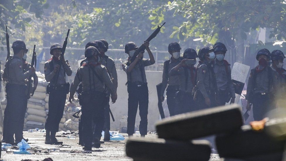 Police officers search for hiding demonstrators