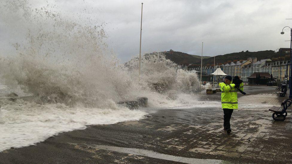 Waves crashing over Aberystwyth promenade