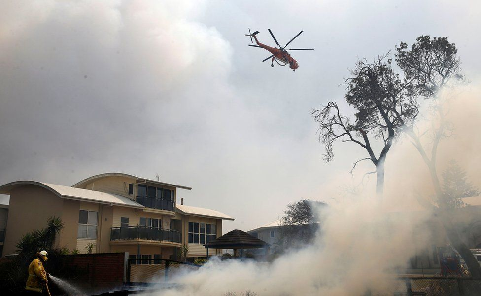 Helicopter drops water in Old Bar, NSW