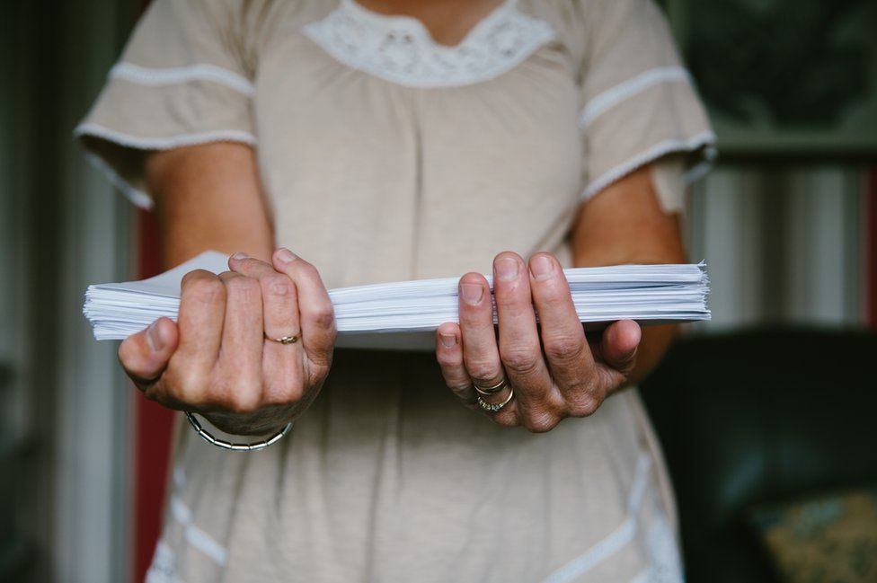 Jackie Cheetham holds some of the correspondence regarding her surgery