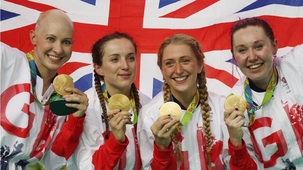 Gold medallists Joanna Rowsell-Shand, Elinor Barker, Laura Trott and Katie Archibald of Great Britain celebrate on the podium at the medal ceremony for the Women's Team Pursuit on Day 8 of the Rio 2016 Olympic Games