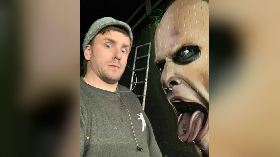Nathan Murdock with mural of Keith Flint