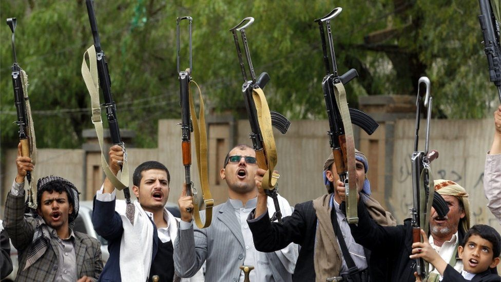 Armed tribesmen, loyal to the Shia Houthi rebels, shout slogans and brandish weapons during a gathering to show support to the rebels, in Sana'a, Yemen, 21 April 2016