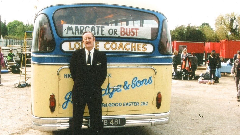 Nicholas Lyndhurst on the set of Rock and Chips standing in front of a bus