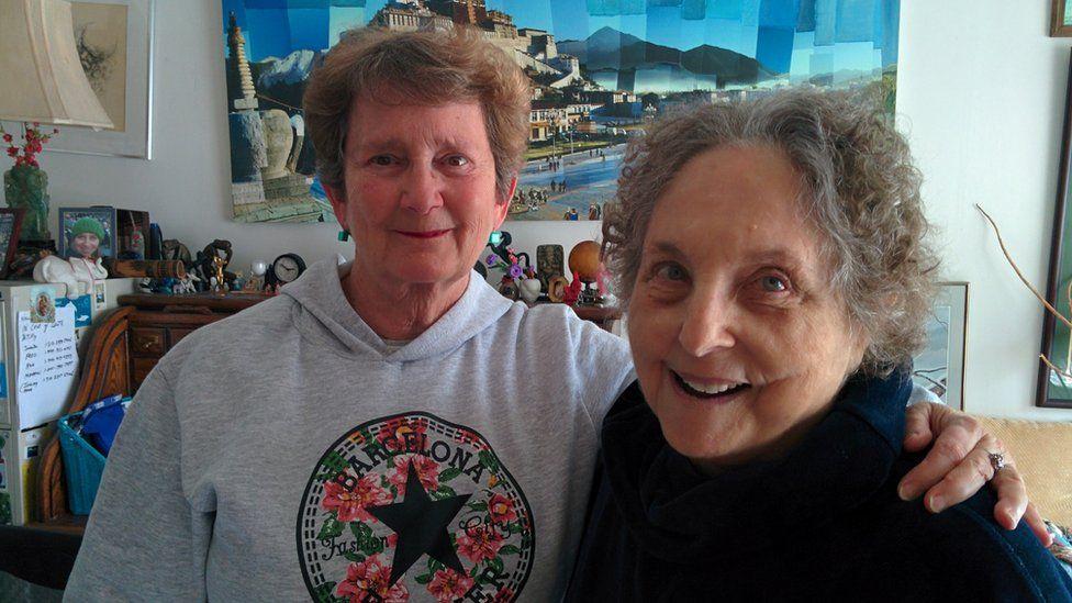 Laura (left) photographed with fellow-survivor Claire Janaro