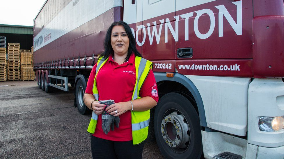 Leonie John in front of a lorry and trailer