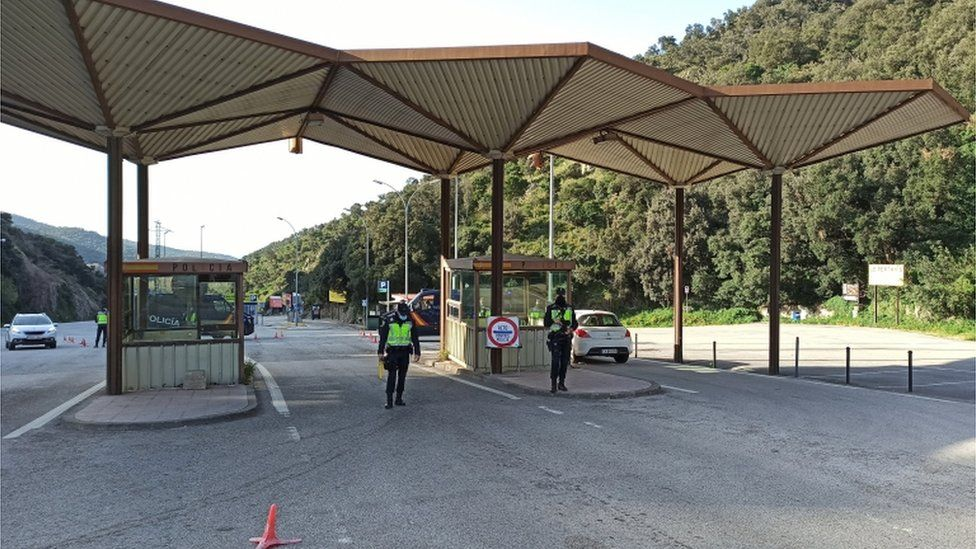 Spanish police at the check point in La Jonquera, which is on the border with France