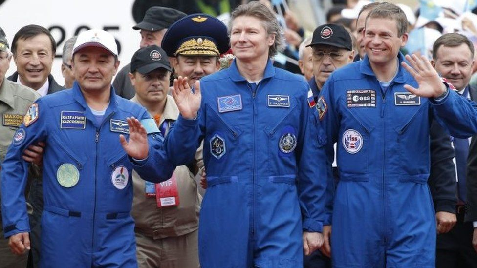 Expedition 44 crew member Gennady Padalka (C) of Roscosmos, visiting crew members Andreas Mogensen (R) of the European Space Agency (ESA) and Aidyn Aimbetov (L) of the Kazakh Space Agency, are welcomed on arrival to Astana, Kazakhstan - 12 September 2015