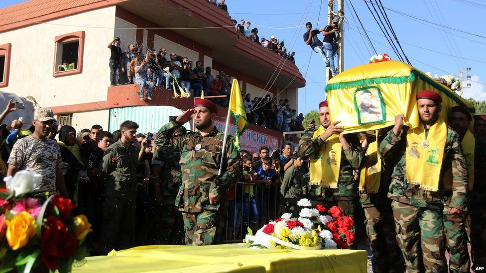 Hezbollah fighters in southern Lebanon carry the coffin of a comrade killed fighting alongside Syrian government forces in the Zabadani area (11 August 2015)