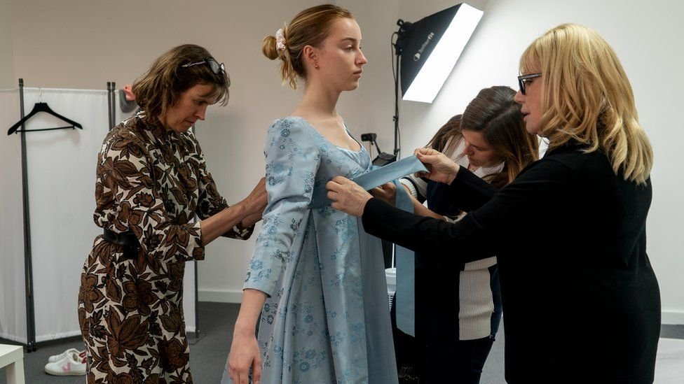 Phoebe Dynevor having her costume fitted