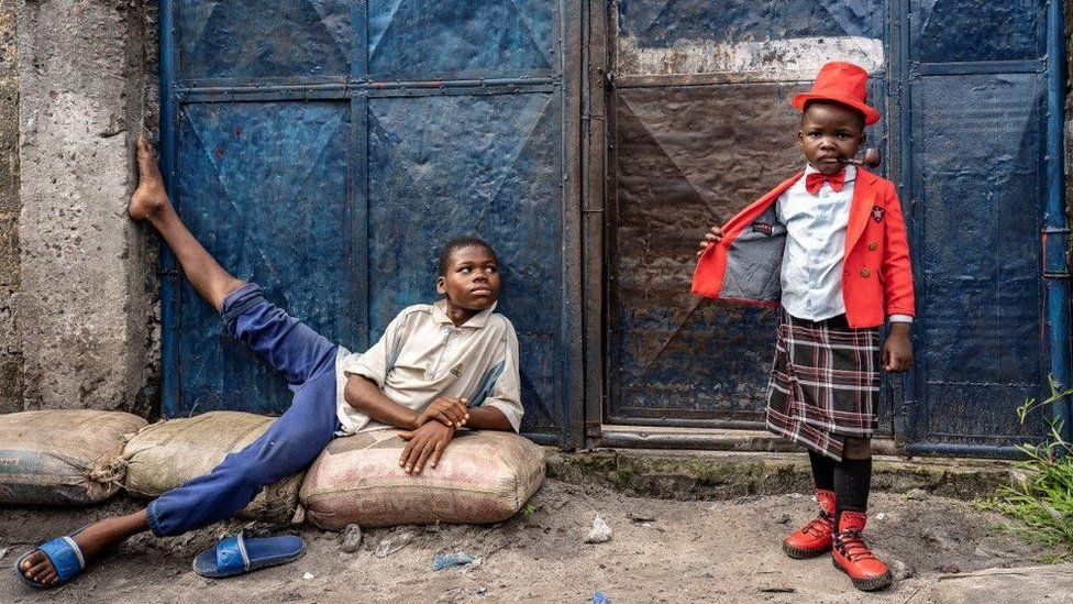 Israell Mbona and older child