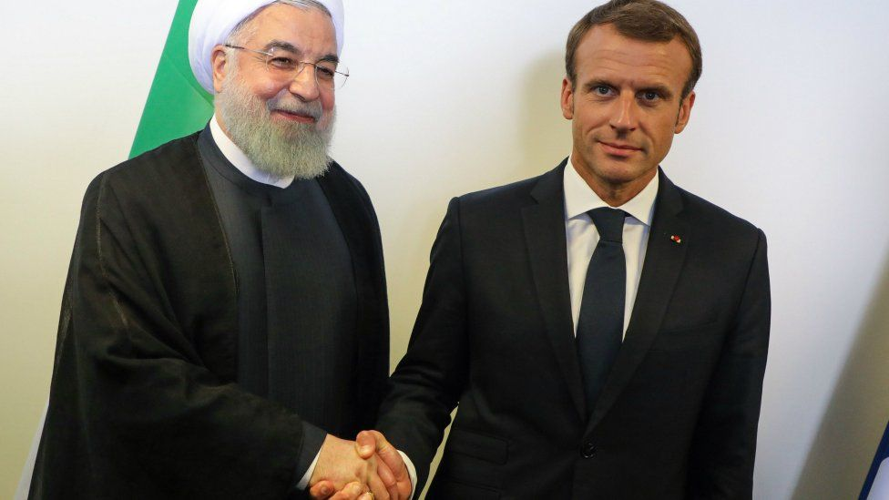 French President Emmanuel Macron (R) meets Iranian President Hassan Rouhani on the sidelines of the UN General Assembly on September 25, 2018