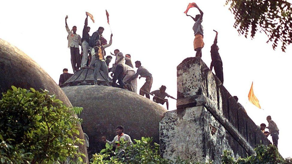 Right-wing Hindu youths atop the Babri Mosque on 6 December, 1992, hours before it was demolished by hundreds.