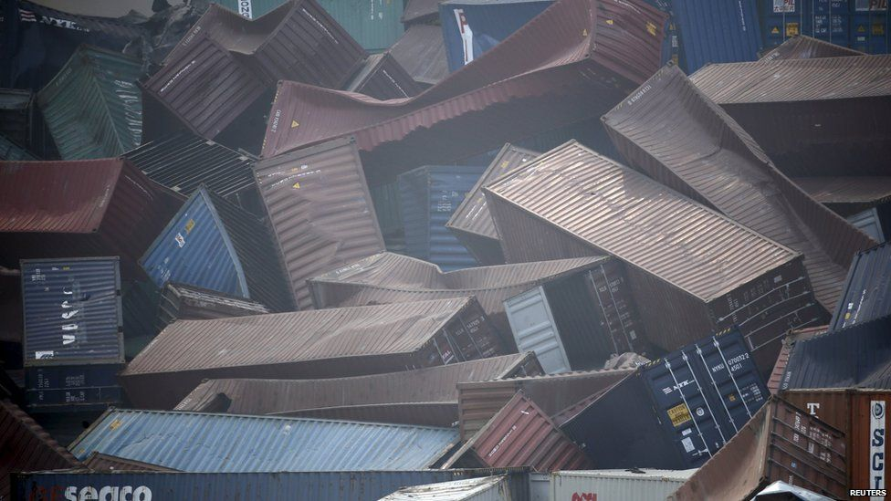 Shipping containers buckled in the aftermath of explosions at Tianjin
