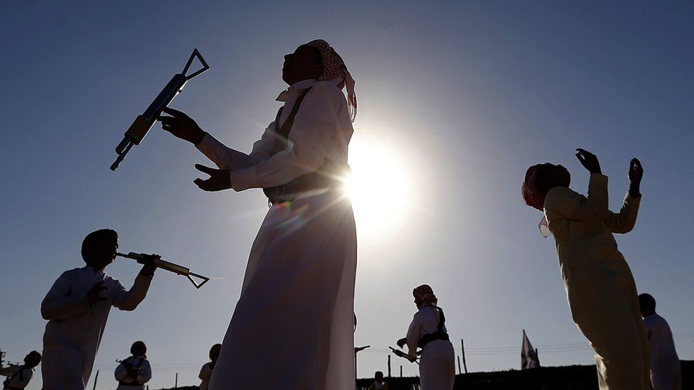 Emiratis dance the yola during the Sheikh Sultan Bin Zayed al-Nahyan Camel Festival on the outskirts of Abu Dhabi on 15 February 2013