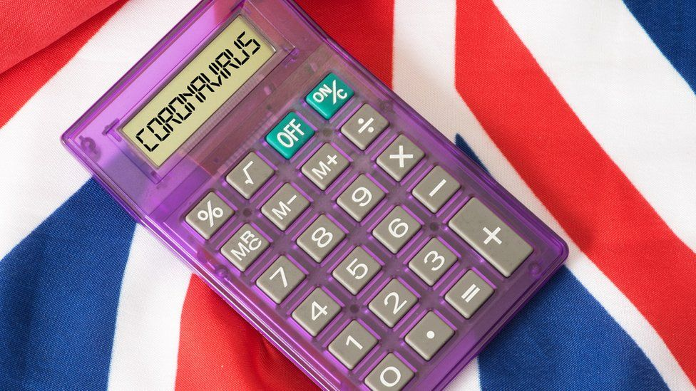 "UK flag with a calculator - the word ""coronavirus"" is on the screen"