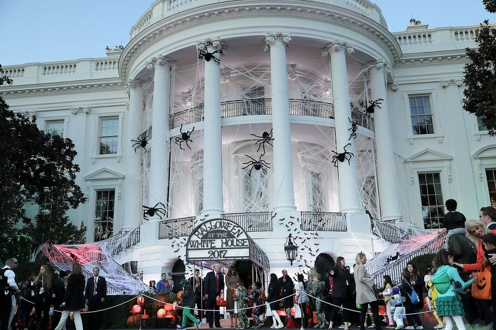 President Donald Trump and First Lady Melania Trump host Halloween at the White House on the South Lawn on 30 October 2017 in Washington, DC. The first couple gave cookies away to costumed trick-or-treaters one day before the Halloween holiday.