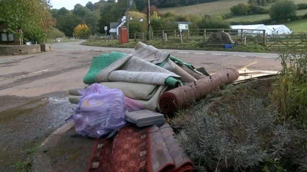 A pile of rugs and carpet