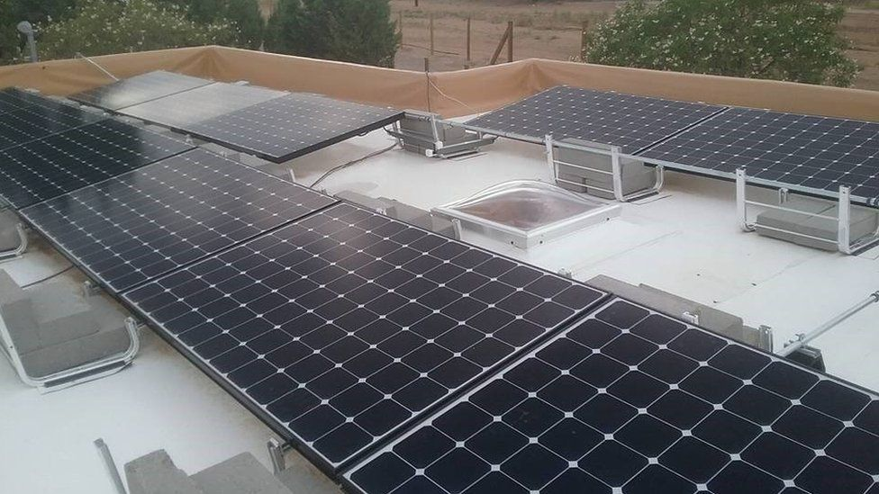 Solar panel covered roofs are painted white in Albuquerque